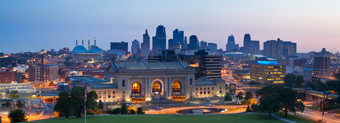 A beautifully lit Kansas City skyline at dusk